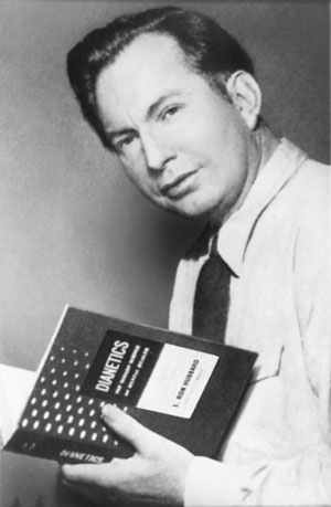 L_Ron_Hubbard_with_Dianetics_book.jpg