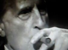 Duchamp-smoking-through-the-cracked-glass